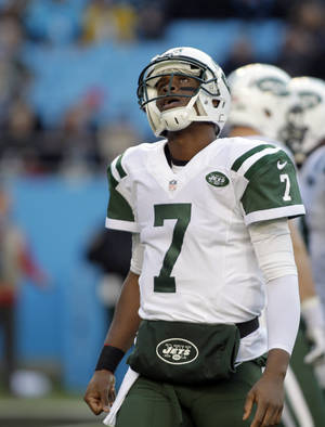Photo - New York Jets quarterback Geno Smith (7) looks up after being sacked by the Carolina Panthers during the first half of an NFL football game in Charlotte, N.C., Sunday, Dec. 15, 2013. (AP Photo/Bob Leverone)