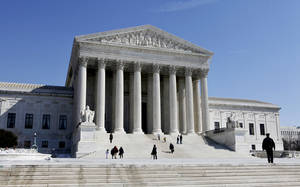Photo - The U.S. Supreme Court building is in Washington. AP FILE PHOTO