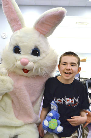 Photo - The Easter Bunny visits with Jacob Clarke on Wednesday at The Children's Center in Bethany.