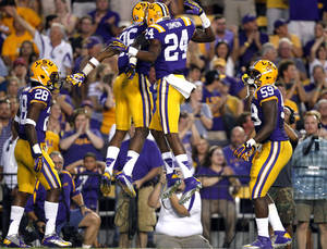 Photo -   LSU safety Ronald Martin (26) celebrates his interception with cornerback Tharold Simon (24) in the first half of their NCAA college football game against Idaho in Baton Rouge, La., Saturday, Sept. 15, 2012. LSU won 63-14. (AP Photo/Gerald Herbert)