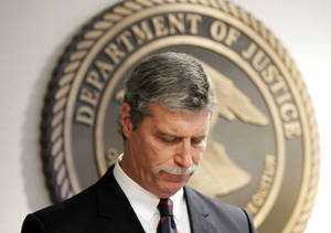 Photo - Jim Letten, U.S. Attorney for the Eastern District, announces his resignation during a news conference in New Orleans, Thursday, Dec. 6, 2012.  Letten said his resignation is effective Dec. 11 and that he plans to stay on with the department briefly to help with the transition in leadership. (AP Photo/Gerald Herbert)