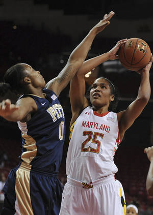 Photo - Maryland forward Alyssa Thomas (25) prepares to shoot as Pittsburgh's Asia Logan (0) defends during the first half of an NCAA college basketball game Thursday, Feb. 6, 2014, in College Park, Md.(AP Photo/Gail Burton)