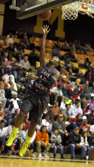 Photo - GIRLS HIGH SCHOOL BASKETBALL TOURNAMENT:  T'ona Edwards shoots a layup during the girls basketball game between Northeast and Midwest City at the Midwest City/Del City Holiday Inviational,  Saturday,Dec. 29, 2012. Photo by Sarah Phipps, The Oklahoman