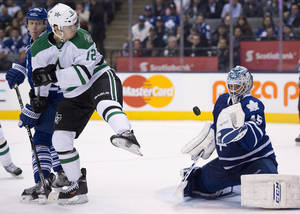 Photo - Toronto Maple Leafs goaltender Jonathan Bernier makes a save as defenseman Carl Gunnarsson (36) tries to control Dallas Stars right winger Alex Chiasson (12) during the third period of an NHL hockey game, Thursday, Dec. 5, 2013 in Toronto. (AP Photo/The Canadian Press, Frank Gunn)