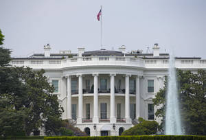 Photo - The South Portico of the White House in Washington on Friday, May 9, 2014. A bevy of solar panels blanketing the roof of the White House is getting its day in the sun. Technicians have finished installing the panels at the nation's most famous address. The milestone completes a project that President Barack Obama hopes will send a clear signal that renewable energy is both feasible and environmentally shrewd.  (AP Photo/Pablo Martinez Monsivais)