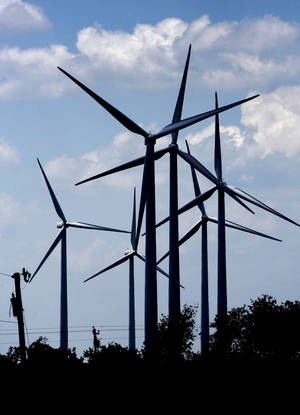 Photo - Wind turbines southwest of Weatherford are seen.   PHOTO BY STEVE SISNEY, THE OKLAHOMAN ARCHIVES <strong>Steve Sisney - The Oklahoman</strong>