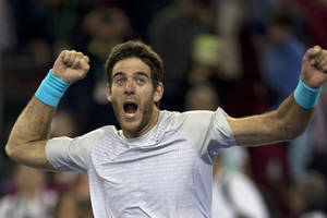 Photo - Argentina's Juan Martin del Potro celebrates his win over Spain's Rafael Nadal during a semifinal match for the Shanghai Masters tennis tournament at the Qizhong Forest Sports City Tennis Center in Shanghai, China, Saturday, Oct. 12, 2013. Del Potro won 6-2, 6-4. (AP Photo/Ng Han Guan