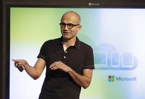 Photo - Microsoft CEO Satya Nadella gestures while speaking during a press briefing on the intersection of cloud and mobile computing Thursday, March 27, 2014, in San Francisco. Microsoft unveiled Office for the iPad, a software suite that includes programs such as Word, Excel and PowerPoint, and works on rival Apple Inc.'s hugely popular tablet computer. (AP Photo/Eric Risberg)