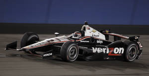 Photo - FILE - In this Oct. 19, 2013 file photo, Will Power (12), of Australia, races towards victory in the IndyCar auto race at the Auto Club Speedway, in Fontana, Calif. IndyCar has reached a multi-year agreement with Verizon that will make the telecommunications giant the title sponsor of the series.  Verizon replaces former title sponsor Izod and its sponsorship of what will now be known as the Verizon IndyCar Series launches with the March 30 season opening race. (AP Photo/Alex Gallardo, File)