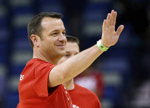 Photo - Louisville head coach Jeff Walz waves during practice at the Women's Final Four of the NCAA college basketball tournament, Saturday, April 6, 2013, in New Orleans. Louisville plays California in a semifinal game on Sunday. (AP Photo/Dave Martin)