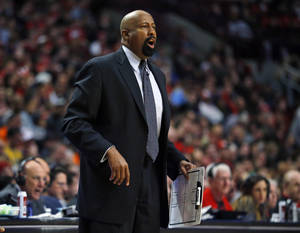 Photo - New York Knicks coach Mike Woodson yells to his team during the second half of an NBA basketball game against the Chicago Bulls on Sunday, March 2, 2014, in Chicago. The Bulls won 109-90. (AP Photo/Jeff Haynes)