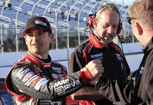Photo -   Jeff Gordon celebrates with his team after winning the pole position for Sunday's NASCAR Sprint Cup Series auto race at New Hampshire Motor Speedway in Loudon, N.H., Friday, Sept. 21, 2012. (AP Photo/Jim Cole)