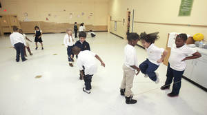 photo - School children jump rope in the old gym at Horace Mann Elementary School in Oklahoma City, OK, Thursday, January 31, 2013,  By Paul Hellstern, The Oklahoman