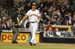 Photo - San Diego Padres' Will Venable walks away from home plate after striking out to end the Padres' 5-1 loss to the Chicago Cubs in a baseball game Thursday, May 22, 2014, in San Diego. Padres hitters struck out ten times in the game.  (AP Photo/Lenny Ignelzi)