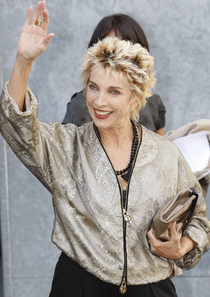 "Photo - FILE - In this, Monday, Sept. 22, 2008 file photo, Italian actress Mariangela Melato waves to photographers prior to the start of the Giorgio Armani Spring/Summer 2009 fashion collection, presented in Milan, Italy. Melato, 71, known for her critically acclaimed performance as a spoiled socialite stranded with a sailor she had tormented in the 1974 film comedy ""Swept Away"" has died in a Rome hospital. The Antea hospital said she died Friday, Jan. 11, 2013. The LaPresse news agency said she was suffering from pancreatic cancer. The blonde actress obtained her most success in a series of films in the 1970s directed by the Italian Lina Wertmuller, including ""The Seduction of Mimi"" and ""Love and Anarchy."" (AP Photo/Luca Bruno, File)"