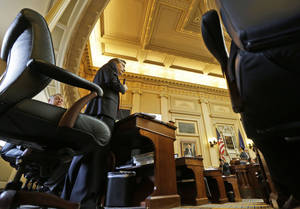 Photo - Del. Chris Jones, R-Suffolk, gestures as he talks about the conference committee report on the transportation funding bill on the floor of the House at the Capitol in Richmond, Va., Friday, Feb. 22, 2013.   The House passed the bill. (AP Photo/Steve Helber)