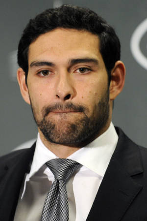 Photo - New York Jets quarterback Mark Sanchez talks during a post-game news conference after of an NFL football game against the Arizona Cardinals, Sunday, Dec. 2, 2012, in East Rutherford, N.J. The Jets won 7-6.  (AP Photo/Bill Kostroun)