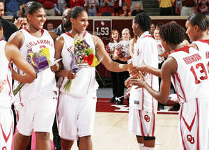 photo - Courtney Paris, left, and Ashley Paris greet Danielle Robinson and Jasmine Hartman during 2009 senior night festivities. While the Paris sisters have moved on, they left a big impact with the players they helped recruit to the program and the example they set for their teammates.  PHOTO BY NATE BILLINGS, THE OKLAHOMAN ARCHIVE