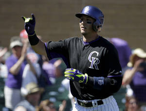 Photo - Colorado Rockies' Troy Tulowitzki celebrates a home run against the Kansas City Royals during the second inning of a spring exhibition baseball game in Scottsdale, Ariz., Monday, March 24, 2014. (AP Photo/Chris Carlson)