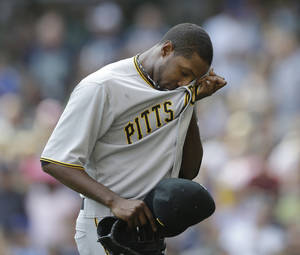 photo -   Pittsburgh Pirates starting pitcher James McDonald reacts after being removed against the Milwaukee Brewers during the third inning of a baseball game on Sunday, Sept. 2, 2012, in Milwaukee. (AP Photo/Jeffrey Phelps)