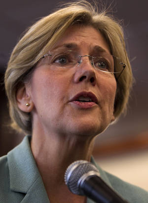 Photo -   Democratic candidate for the U.S. Senate Elizabeth Warren faces reporters during a news conference at Liberty Bay Credit Union headquarters, in Braintree, Mass., Wednesday, May 2, 2012. Warren responded to questions on her Native American heritage. (AP Photo/Steven Senne)
