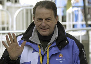 Photo - FILE - This is a Monday, Feb. 11, 2002  file photo of International Olympic Committee President Jacques Rogge as he waves to the crowd while visiting the men's singles luge at the 2002 Salt Lake City Winter Olympics in Park City, Utah. (AP Photo/Joe Cavaretta, File)