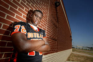Photo - Douglass offensive lineman Cayman Bundage has committed to Arizona.  Photo by Steve Gooch, The Oklahoman Archive