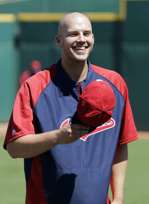 "Photo - Cleveland Indians pitcher Justin Masterson tips his hat to fans singing ""Happy Birthday"" before a spring exhibition baseball game against the Colorado Rockies, Saturday, March 22, 2014, in Goodyear, Ariz. Masterson, who will be the Indians opening day starter, celebrated his 29th birthday Saturday. (AP Photo/Mark Duncan)"