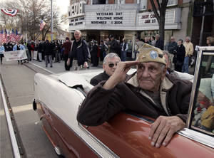 "Photo - FILE - This Nov. 11, 2004 file photo shows William ""Wild Bill"" Guarnere participating in the Veterans Day parade in Media, Pa. Guarnere, one of the World War II veterans whose exploits were dramatized in the TV miniseries ""Band of Brothers,"" has died, Sunday, March 9, 2014, at the age of 90.  (AP Photo/Jacqueline Larma, file)"