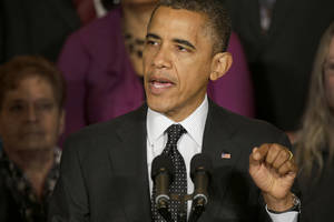 Photo -   President Barack Obama gestures as he speaks about the economy and the deficit, Friday, Nov. 9, 2012, in the East Room of the White House in Washington. (AP Photo/Pablo Martinez Monsivais)