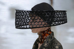 Photo -   A model wears a creation by British designer Sarah Burton for Alexander McQueen as part of the ready to wear Spring-Summer 2013 collection, in Paris, Tuesday, Oct. 2, 2012. (AP Photo/Francois Mori)