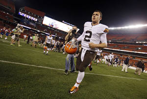 Photo - Cleveland Browns quarterback Johnny Manziel (2) runs off the field after a 33-14 loss to the St. Louis Rams in a preseason NFL football game Saturday, Aug. 23, 2014, in Cleveland. (AP Photo/Tony Dejak)