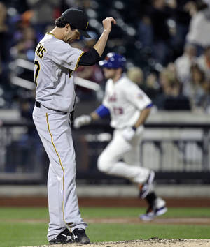 Photo -   Pittsburgh Pirates relief pitcher Jeff Karstens reacts after allowing a three-run home run to New York Mets' Ike Davis during the fifth inning of a baseball game in New York, Monday, Sept. 24, 2012. (AP Photo/Kathy Willens)