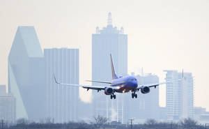 Photo - A Southwest Airlines jet comes in for a landing at Love Field in Dallas.  AP File Photo <strong>LM Otero -   </strong>