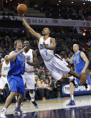 Photo -   Charlotte Bobcats' Ramon Sessions (7) drives past Dallas Mavericks' Troy Murphy (6) during the first half of an NBA basketball game in Charlotte, N.C., Saturday, Nov. 10, 2012. (AP Photo/Chuck Burton)
