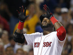 Photo - Boston Red Sox designated hitter David Ortiz celebrates his solo home run as he crosses the plate during the fourth inning of a baseball game against the Detroit Tigers at Fenway Park in Boston, Wednesday, Sept. 4, 2013. (AP Photo/Elise Amendola)
