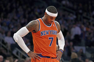 Photo - New York Knicks' Carmelo Anthony (7) waits during a break late in the second half action of an NBA basketball game against the Atlanta Hawks Saturday, Nov. 16, 2013, in New York.  Atlanta defeated New York 110-90. (AP Photo/Jason DeCrow)