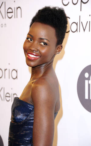 Photo - Lupita Nyong'o attends the IFP and Calvin Klein Women In Film Party at the 67th international film festival, Cannes, southern France, Thursday, May 15, 2014. (Photo by Arthur Mola/Invision/AP)