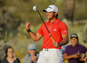 Photo - Jason Day, of  Australia, celebrates on the 23rd hole after winning his championship match against Victor Dubuisson, of France, during the Match Play Championship golf tournament, Sunday, Feb. 23, 2014, in Marana, Ariz. (AP Photo/Matt York)