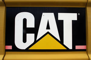Photo - FILE - In this June 13, 2012 file photo, the Caterpillar logo is seen on earth moving equipment in Springfield, Ill. A spokesperson for Caterpillar Inc. said Thursday, June 13, 2013, the Peoria, Ill-based heavy equipment maker it will no longer give money to the Boy Scouts of America because the organization bars homosexual adults from serving as scout leaders. (AP Photo/Seth Perlman, File)