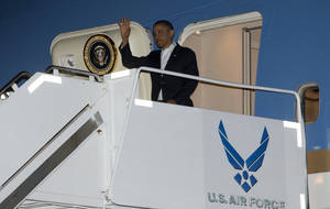 photo - President Barack Obama waves as he gets off Air Force One upon his arrival at Joint Base Pearl Harbor-Hickam, Honolulu, Hawaii, Wednesday, Jan. 2, 2013. The president is back in Hawaii for vacation after a tense, end-of-the-new-year standoff with Congress over the fiscal cliff.  (AP Photo/Carolyn Kaster)