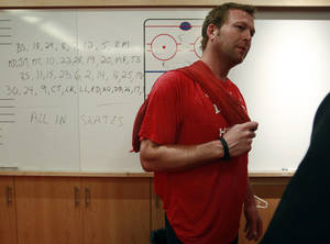 Photo -   New Jersey Devils goalie Martin Brodeur answers a question as the team packs up for the year in Newark, N.J., Wednesday, June 13, 2012. The Devils lost four game to two to the Los Angeles Kings in the Stanley Cup final NHL hockey series. (AP Photo/Mel Evans)