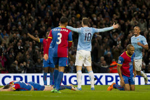 Photo - Manchester City's Edin Dzeko, centre right, celebrates after scoring against Crystal Palace during their English Premier League soccer match at the Etihad Stadium, Manchester, England, Saturday Dec. 28, 2013. (AP Photo/Jon Super)