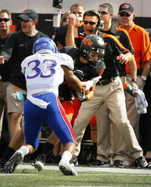 Photo - Oklahoma State head coach Mike Gundy reacts to a reception by Colton Chelf (83) during a college football game between the Oklahoma State University Cowboys (OSU) and the University of Kansas Jayhawks (KU) at Boone Pickens Stadium in Stillwater, Okla., Saturday, Oct. 8, 2011 Photo by Steve Sisney, The Oklahoman