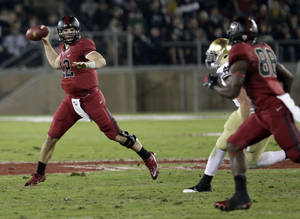Photo - Stanford quarterback Andrew Luck (12) passes to wide receiver Ty Montgomery (88) in the first quarter against Notre Dame in an NCAA college football game in Stanford, Calif., Saturday, Nov. 26, 2011. (AP Photo/Paul Sakuma) ORG XMIT: CAPS104