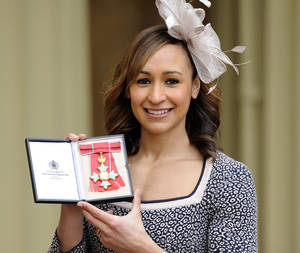 photo - Olympic heptathlon champion Jessica Ennis poses for the media after she received her Commander of the British Empire (CBE) medal from Queen Elizabeth II during an Investiture ceremony at Buckingham Palace in London, Thursday Feb. 28, 2013.  Ennis is among a number of British gold medal winners from the recent London 2012 Olympic Games to be honored by the Queen in recognition of their sporting achievements. (AP Photo / Jonathan Brady, PA) UNITED KINGDOM OUT - NO SALES - NO ARCHIVES