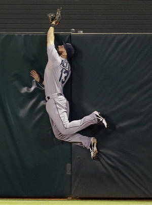 Photo - Seattle Mariners Dustin Ackley can't make the catch on a walk off home run hit by Oakland Athletics' Brandon Moss in the ninth inning of a baseball game Monday, Aug. 19, 2013, in Oakland, Calif. (AP Photo/Ben Margot)