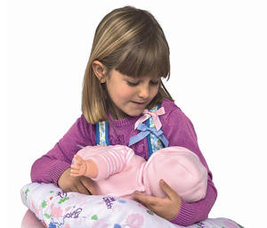 Photo -   This product image released by Berjuan Toys shows a girl playing with The Breast Milk Baby doll. The breastfeeding doll, whose suckling sounds are prompted by sensors sewn into a halter top, has caught some flak after hitting the U.S. market. (AP Photo/Berjuan Toys)