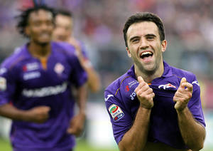 Photo - Fiorentina's Giuseppe Rossi celebrates after scoring during a Serie A soccer match between Fiorentina and Juventus at the Artemio Franchi stadium in Florence, Italy, Sunday, Oct. 20, 2013. (AP Photo/Fabrizio Giovannozzi)