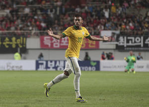 Photo - Brazil's Neymar celebrates after scoring a goal against South Korea during their friendly soccer match at Seoul World Cup Stadium in Seoul, South Korea, Saturday, Oct. 12, 2013. (AP Photo/Ahn Young-joon)